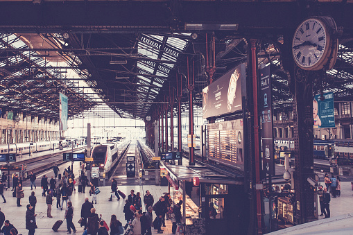 Railway station in Paris with big clock and trrains