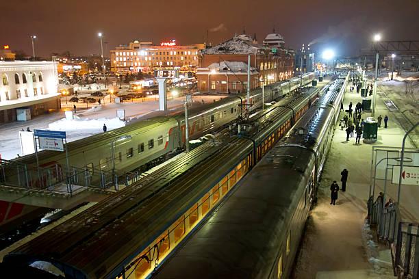 railway station on dark winter day - double_p stockfoto's en -beelden