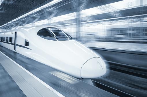 railway station platform motion blur with modern train