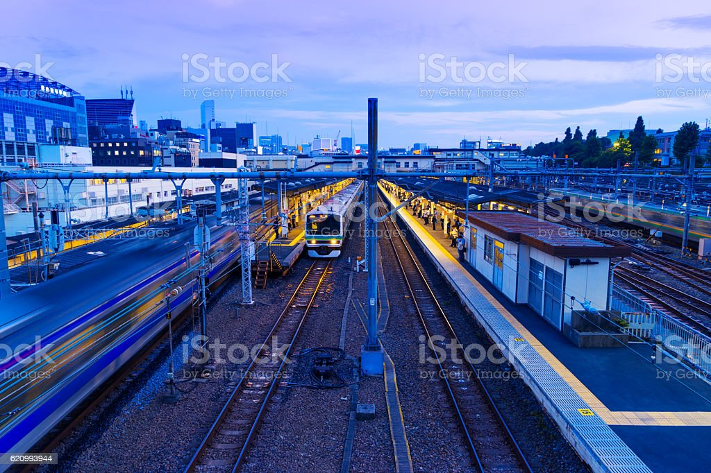 railway station with busy traffic at night in TOKYO stock photo