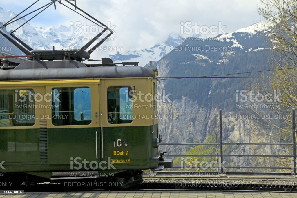 Railway station with swiss train and mountains in Jungfrau, Switzerland. stock photo