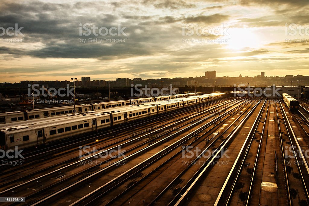 railway station with train under sunset stock photo
