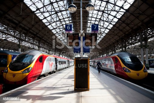 Manchester, UK - May 4, 2011: Manchester Piccadilly railway station with two Virgin Trains Class 390 Pendolino tilting trains await departure. These trains were introduced from 2001 to modernise the West Coast Main Line fleet.