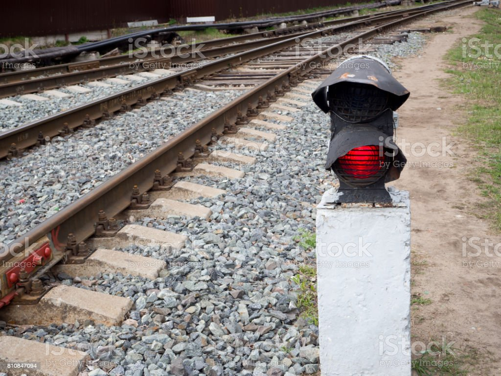 railway. the traffic light is red. it is forbidden to go stock photo