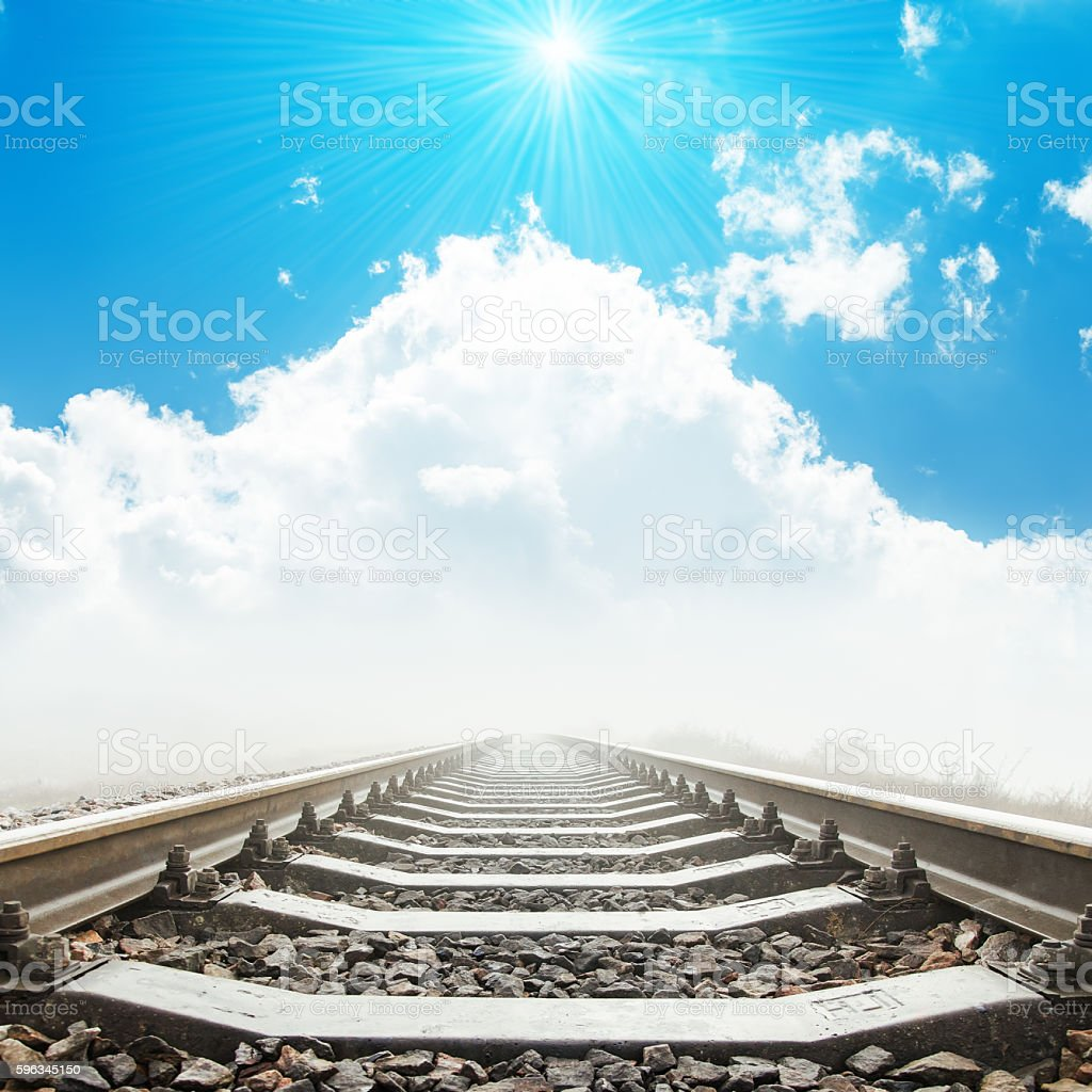 railway to heaven in clouds and sun over it royalty-free stock photo