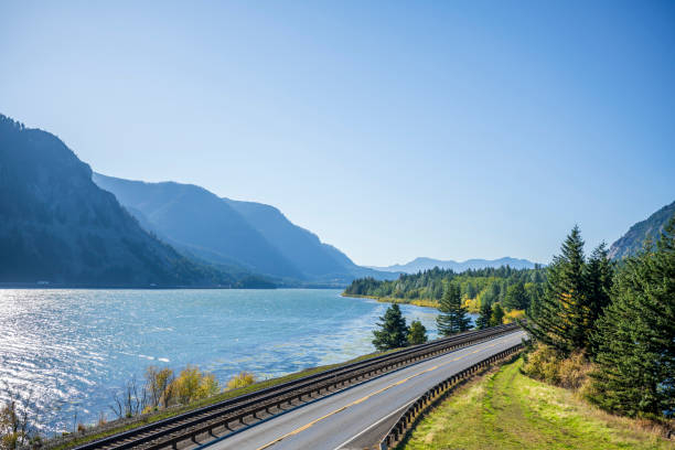Railway track and vehicles road along the Columbia River in Columbia Gorge stock photo