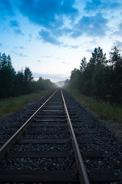Railway track in the evening stock photo