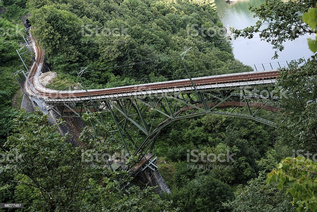 railway track in the swiss alps stock photo