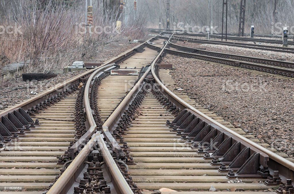Railway track on gravel embankment, with concrete railway ties stock photo