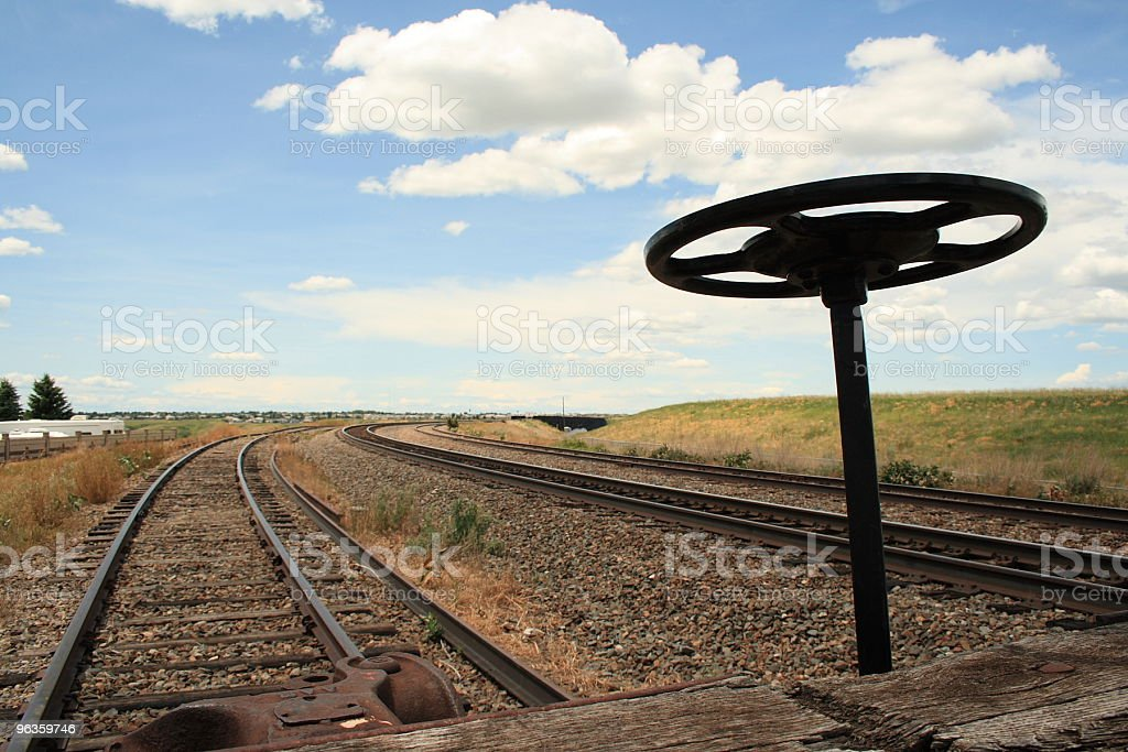 railway tracks and end of car with steering wheel royalty-free stock photo