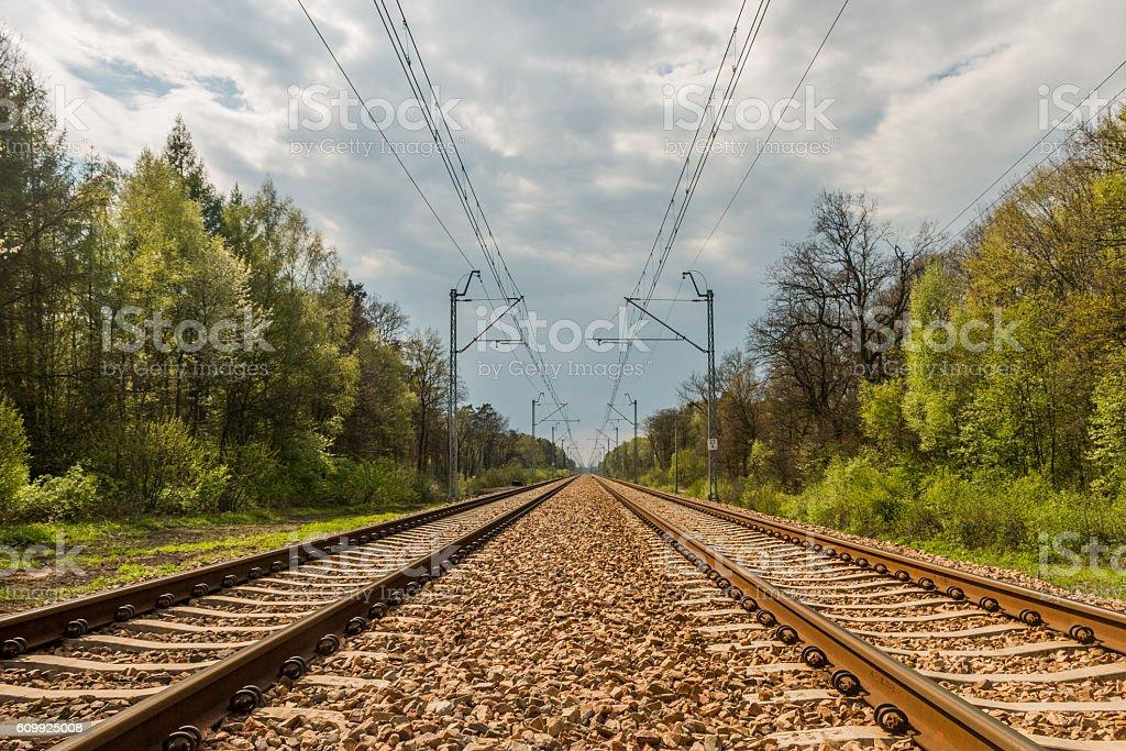 Railway tracks are heading towards the horizon stock photo