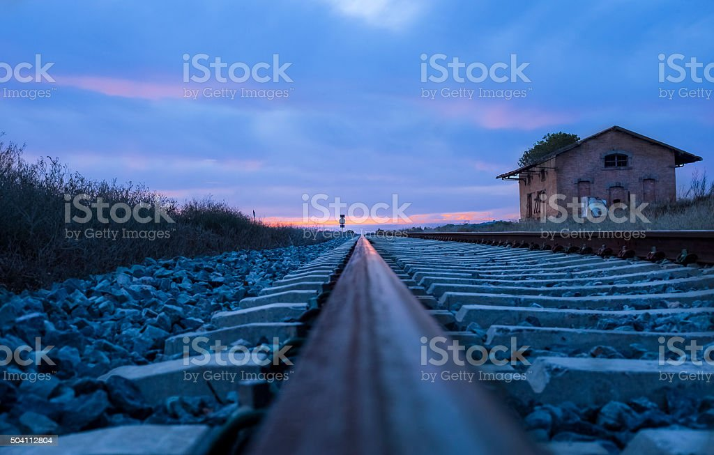 Railway tracks at dusk stock photo