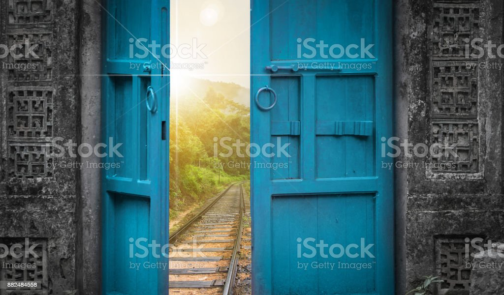 railway tracks behind open door stock photo