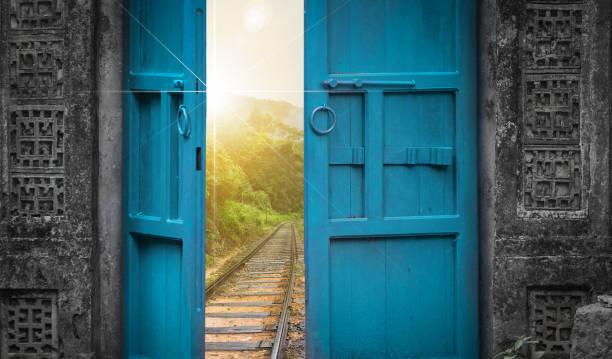 railway tracks behind open door stock photo