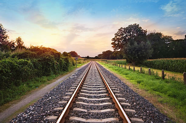 railway tracks railway tracks in a rural scene with nice pastel sunset tramway stock pictures, royalty-free photos & images