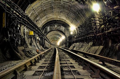 Unused railway tracks leading into the tunnel.