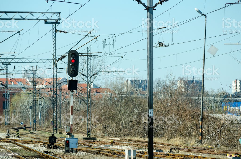 Railway traffic light with railway electrification system. royalty-free stock photo