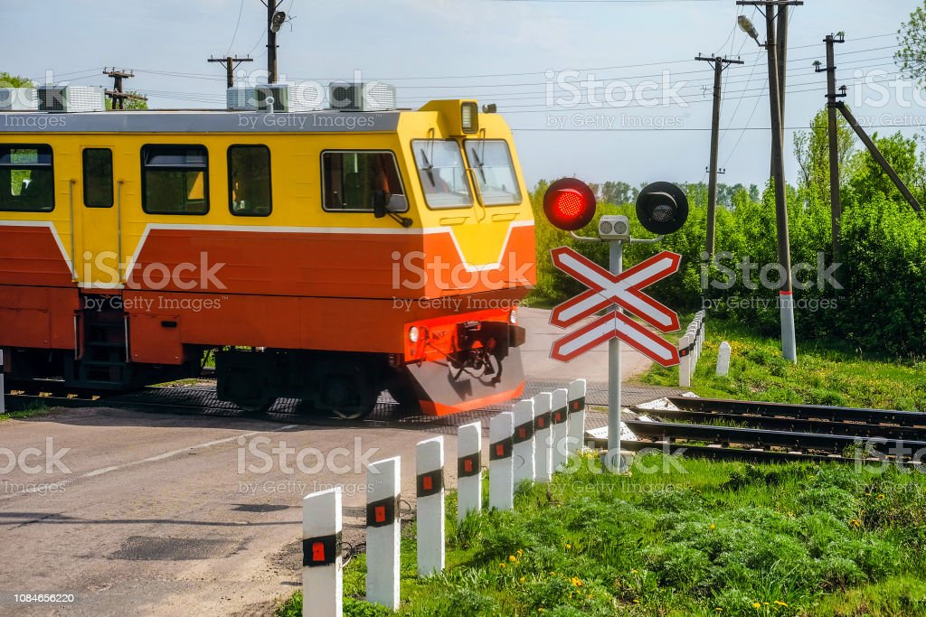 Railway traffic lights with a red signal. Railway crossing with...