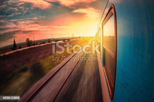 Railway trip With A Train on sunset in move ,shoot with fish-eye lens