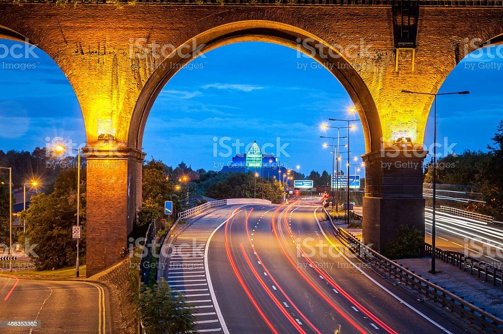 Railway viaduct over motorway stock photo