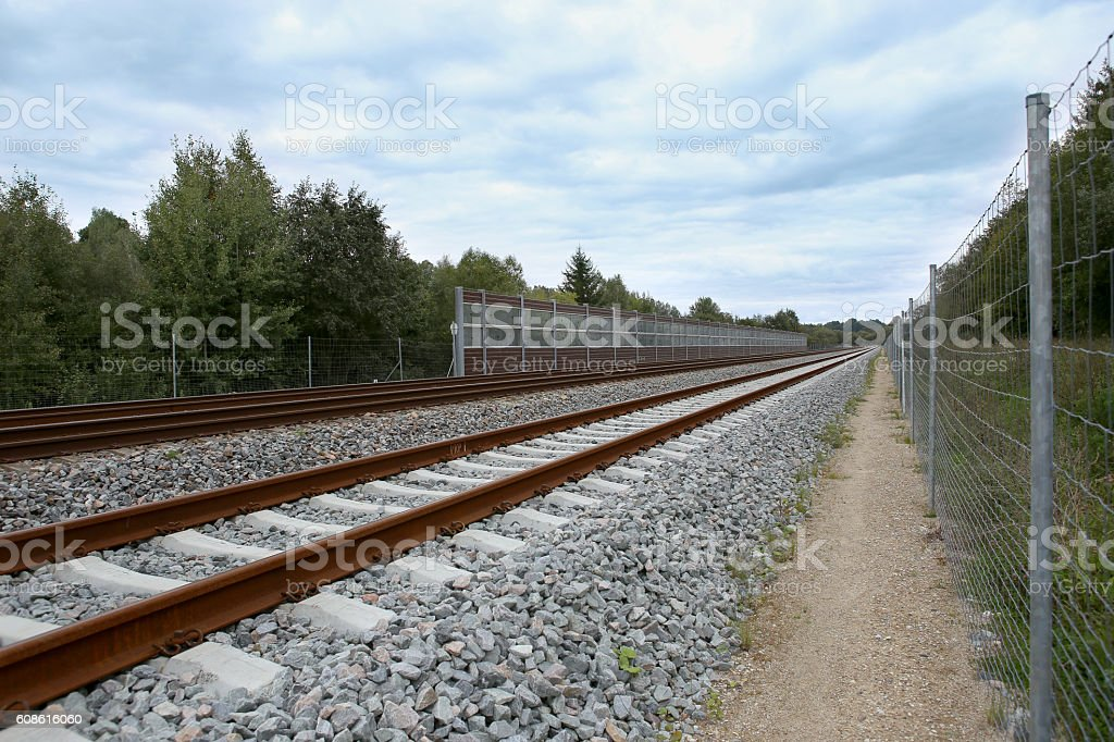 Railway with noise damping wall stock photo