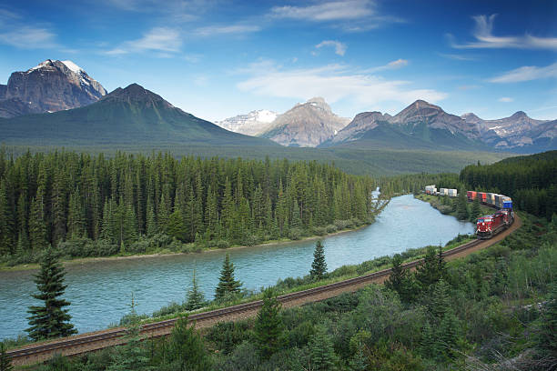 Railway with train in Banff National Park, Canadian Rockies  rocky mountains north america stock pictures, royalty-free photos & images