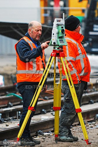istock Railway worker using a Modern 3D scan for a land survey 1077289676