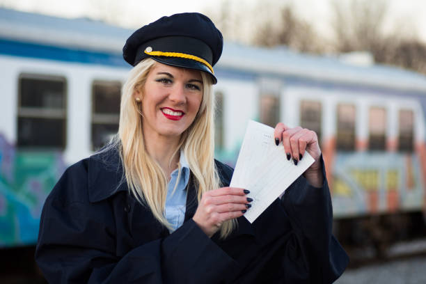 railway worker with tickets - transport conductor stock photos and pictures