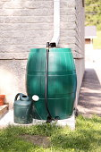 A modern rain barrel used for water conservation.