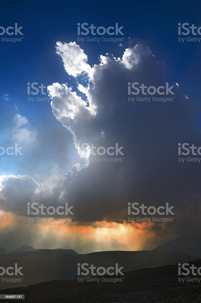 Rain cloud at sunset royalty-free stock photo