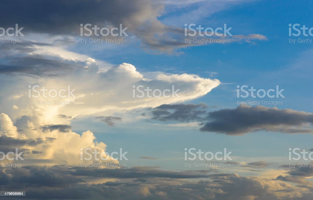 Rain clouds are gathering evening light from the sun stock photo
