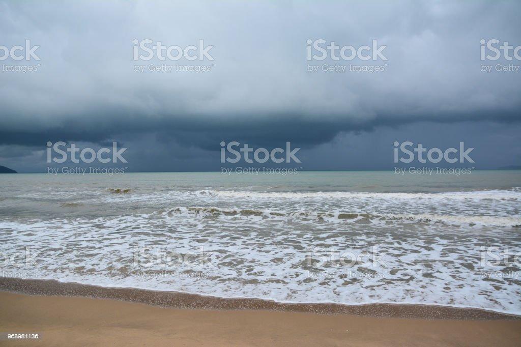 Rain clouds at the beach stock photo