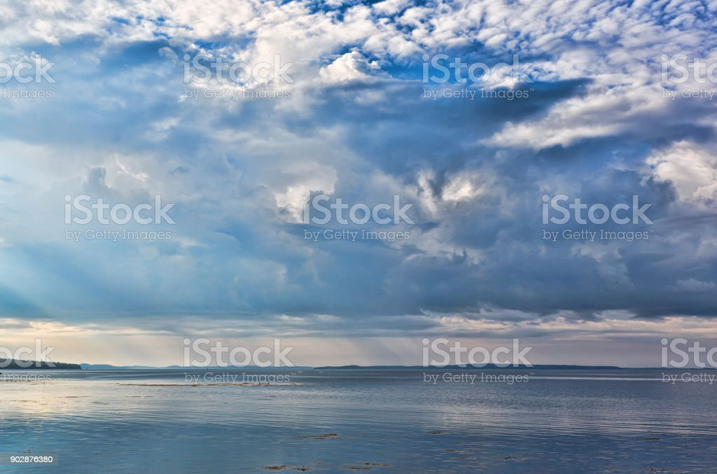 Rain clouds over Penobscot Bay in Maine stock photo