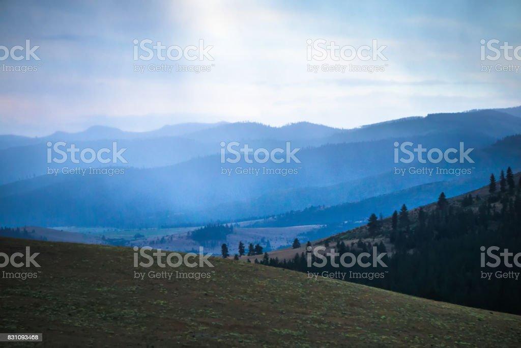 rain clouds passing through flathead  reservation montana stock photo
