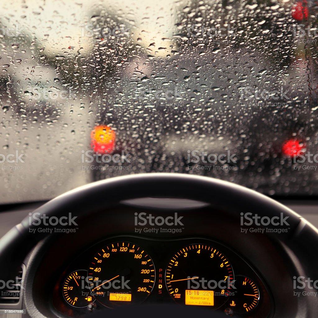 rain droplets on car windshield stock photo