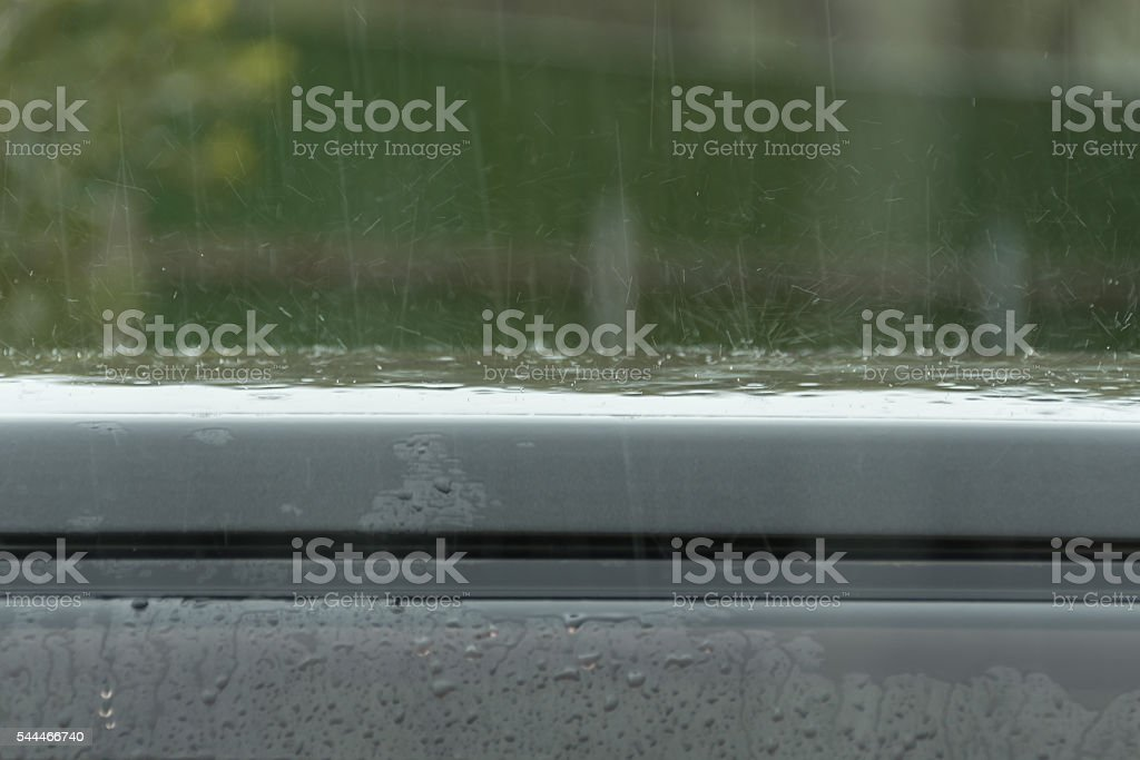 Rain Drops Beat A Car Roof Stock Photo - Download Image Now