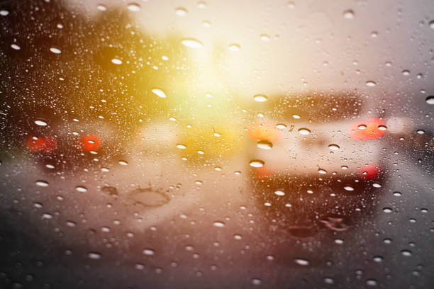 Rain Drops On Car Windscreen Close Up Stock Photo - Download Image