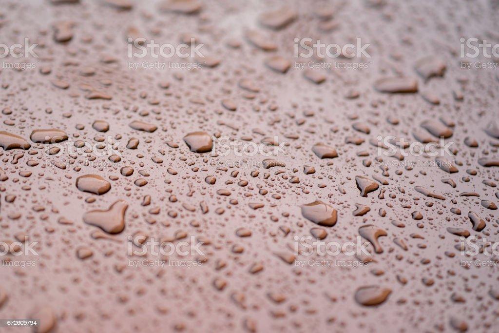 rain drops on gloss Brown surface stock photo
