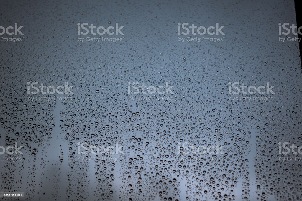 Rain drops on the window glass, with cloudy sky as background - Royalty-free Abstract Stock Photo