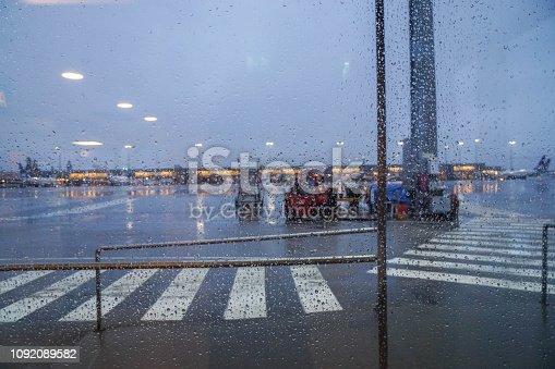 istock rain drops on the window of an airport 1092089582