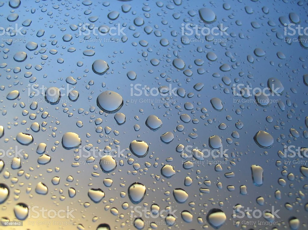 rain drops on the window, sunset in background, stormy clouds royalty-free stock photo