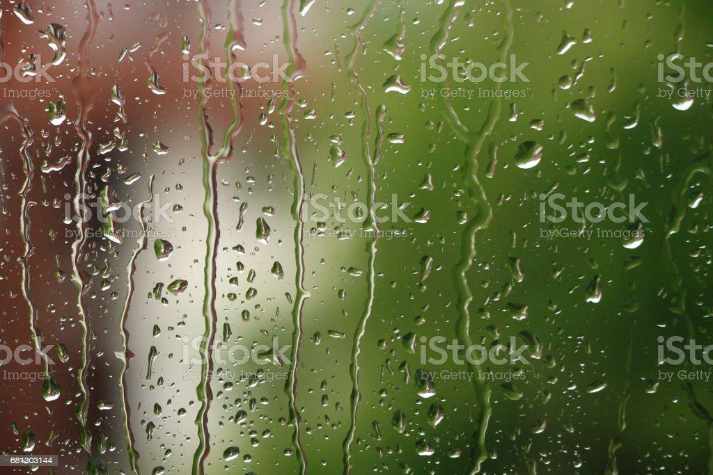 Rain drops on window , rainy day stock photo