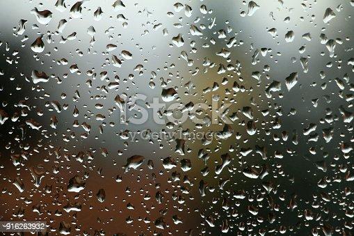 istock Rain drops on window , rainy day 916263932
