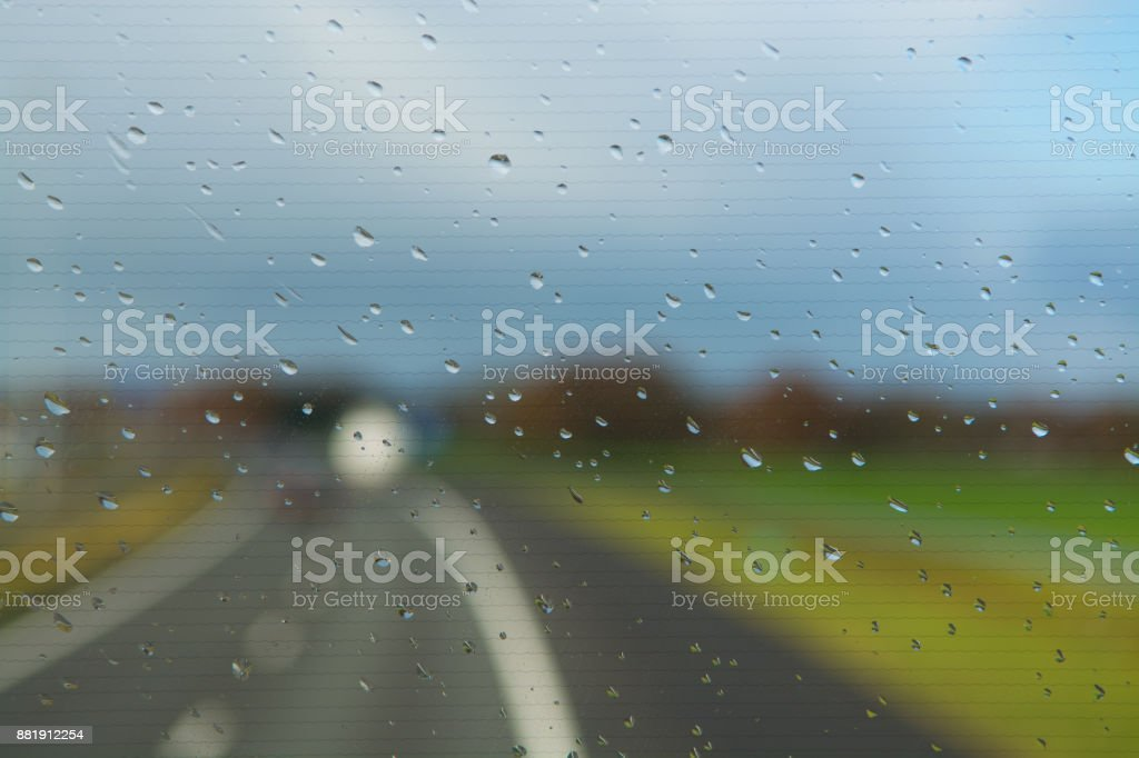 Rain Drops Op Windshield Driving On Highway Stock Photo & More
