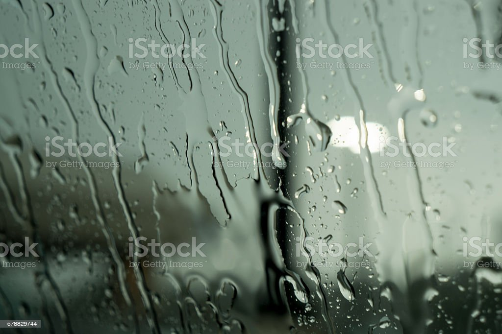 Rain Drops Running Down Window stock photo