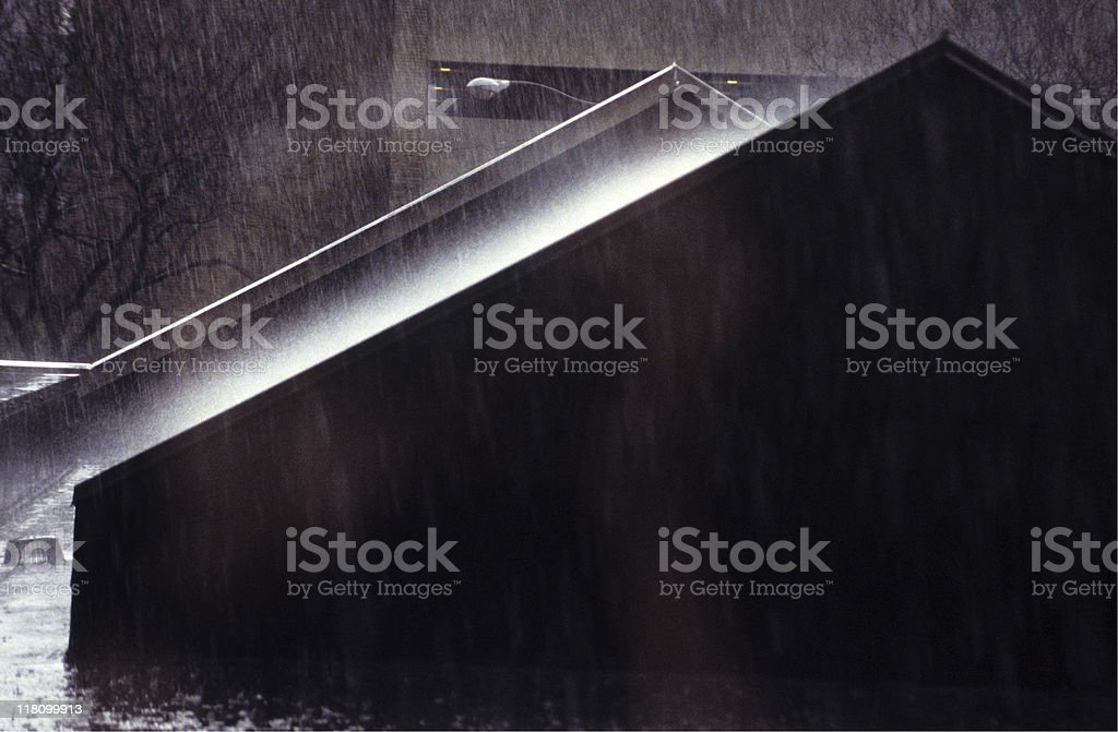 Rain falling over roof with heavy mist, USA, Cleveland royalty-free stock photo