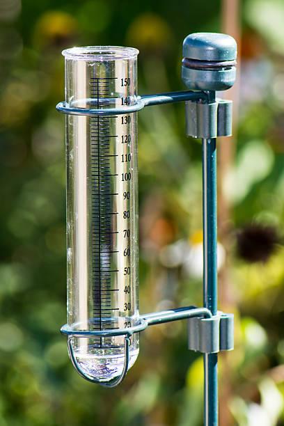 rain gauge in the garden - rain gauge stock photos and pictures