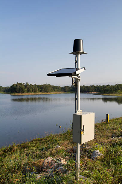 rain gauge on dam - rain gauge stock photos and pictures