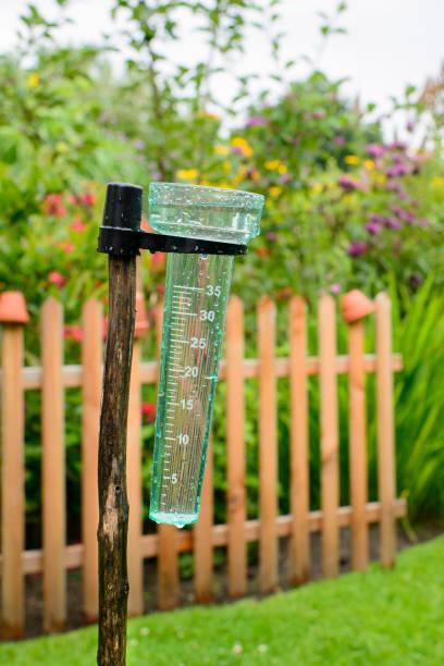 rain gauge - rain gauge stock photos and pictures
