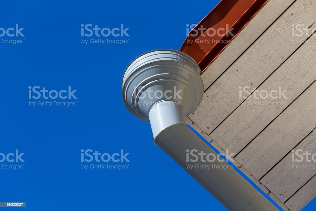 Rain gutter on house stock photo